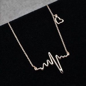 Jewelry - Dainty silver heartbeat heart necklace Nwt